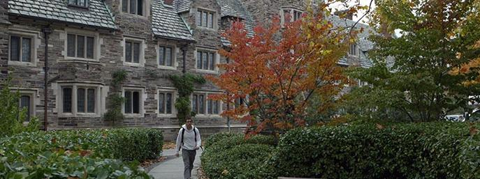 Dorms building and student walking