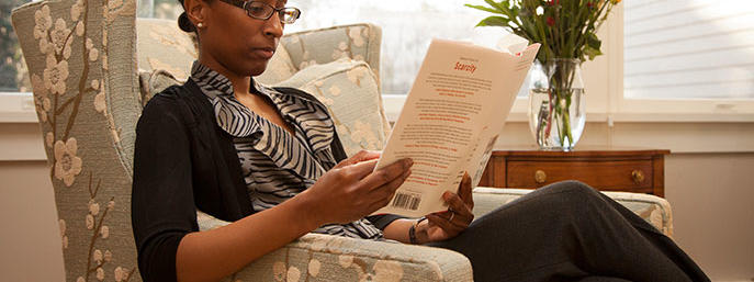 Woman sitting on chair reading
